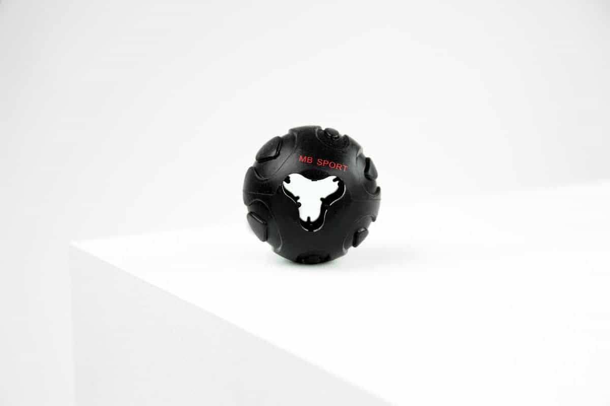 Product shot Black tough rubber ball for dogs