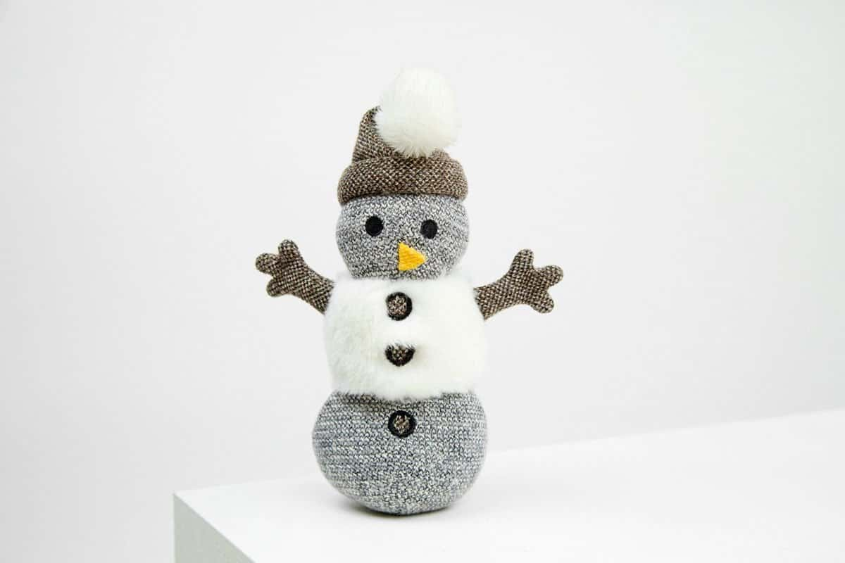 Product shot of a snowman plush toy for dogs